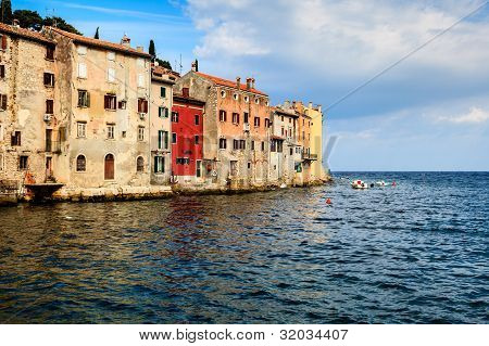 Old Houses Facing Sea In The Medieval City Of Rovinj, Croatia