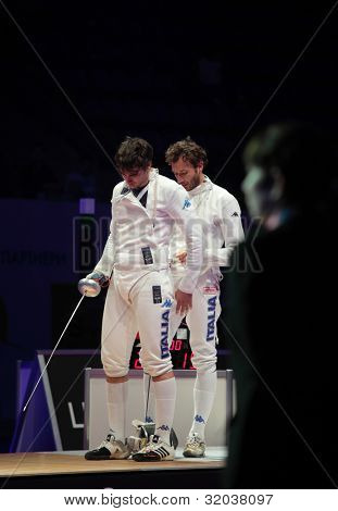 KIEV, UKRAINE - APRIL 14, 2012: Diego Confalonieri replaced by Enrico Garozzo in the match for 3rd place in men's epee during World Fencing Championship on April 14, 2012 in Kiev, Ukraine