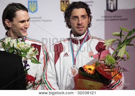 KIEV, UKRAINE - APRIL 14, 2012: Hungarian fencers Andras Redli and Gabor Boczko on medal ceremony during World Fencing Championship on April 14, 2012 in Kiev, Ukraine