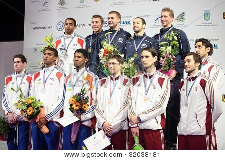 KIEV, UKRAINE - APRIL 14, 2012: All winners of World Fencing Championship in men's epee on April 14, 2012 in Kiev, Ukraine. Teams of USA, France, and Hungary on Medal ceremony