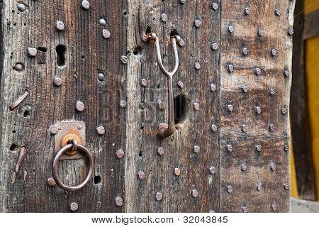 Heavily Studded Oak Door At Entrance To Castle