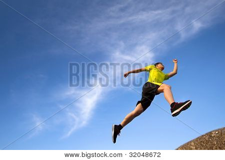 healthy young runner with cloud background