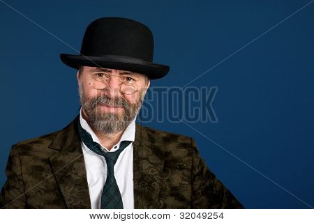 Smiling man in vintage glasses pince nez and bowler hat