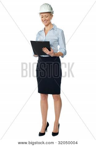 Elderly Female Architect Studying File