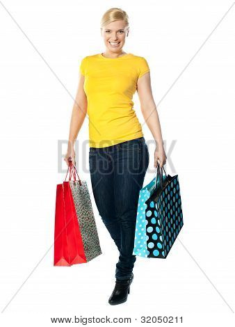 Attractive Girl Carrying Colourful Shopping Bags