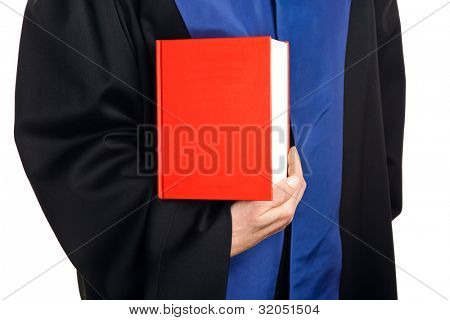 a judge with a law book in court. gavel in hand.