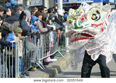 FLUSHING, NY - FEB 12: A Dragon dance team participates in a Chinese New Year Parade on February 12, 2005 in the Flushing neighborhood of New York City.