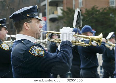 FLUSHING, NY - FEB 12: An unidentified NYPD officer plays a trumpet during a Chinese New Year Parade on February 12, 2005 in the Flushing neighborhood of New York City.