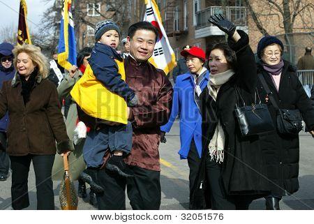 FLUSHING, NY - FEB 12: New York City Councilman John Liu (D-NY) walks with his family during the Chinese New Year Parade on February 12, 2005 in Flushing, NY.