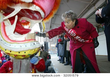 FLUSHING, NY - FEB 12: Queensboro President Helen Marshall reaches for a lucky envelope as she participates in the Chinese New Year Parade on February 12, 2005 in Flushing, New York.