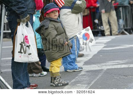 FLUSHING, NY - FEB 12: A young parade holds a Korean flag as he attends the Chinese New Year Parade on February 12, 2005 in the Flushing neighborhood of New York City.
