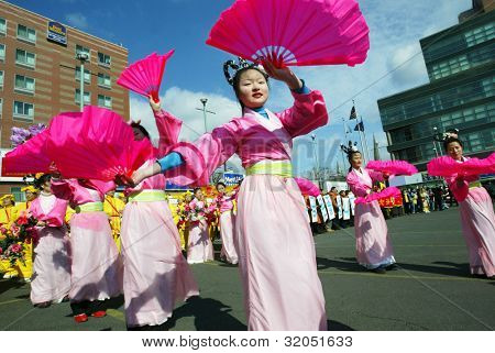 FLUSHING, NY - FEB 12: Korean dancers participate in the Chinese New Year Parade on February 12, 2005 in the Flushing neighborhood of New York City.