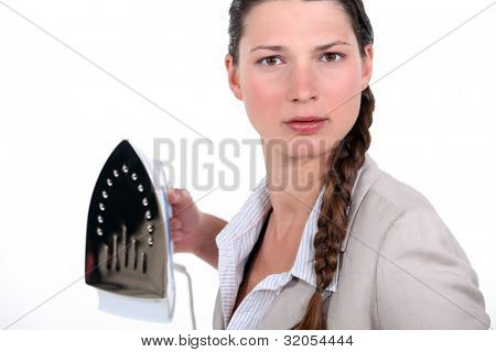 Businesswoman holding iron menacingly