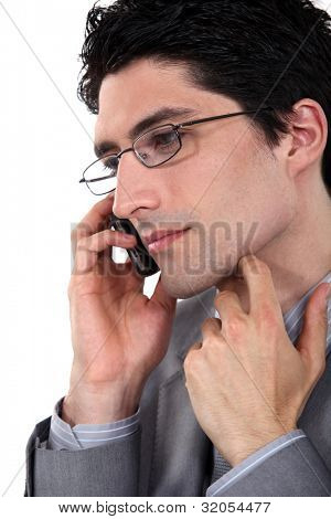 Closeup of a bespectacled businessman on the phone
