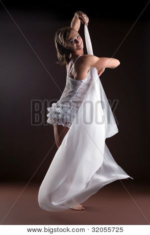 Strong woman body builder with flying veil