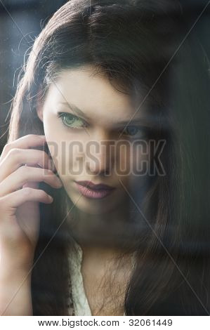 The Thinking Woman At Window Potrayed In Close-up