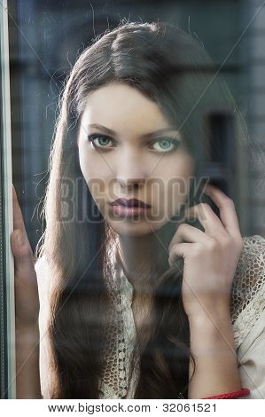 The Thinking Woman At Window