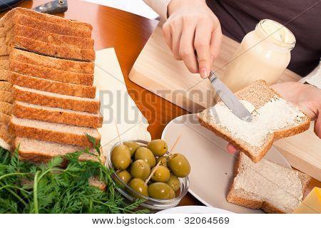 Spreading Mayonnaise On Sandwich
