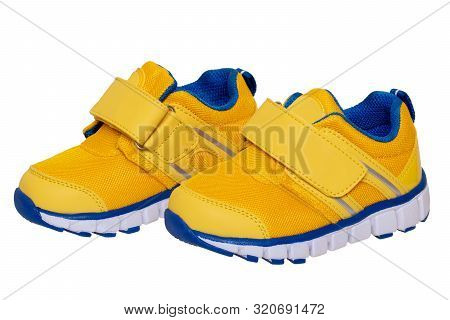 poster of Child Shoe Fashion. Close-up Of A Pair Of Yellow Blue Child Sneaker Or Sport Shoes Isolated On A Whi