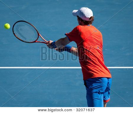 MELBOURNE - JANUARY 25: Andy Murray of Great Britain in his quarter final win over Kei Nishikori of Japan at  the 2012 Australian Open on January 11, 2012 in Melbourne, Australia.