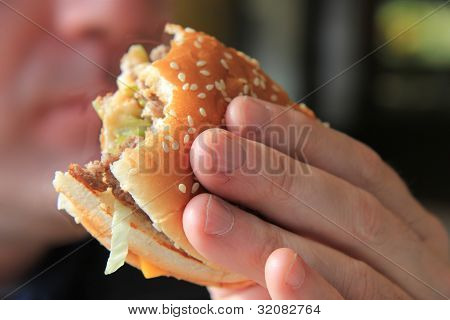 Man Enjoying His Hamburger