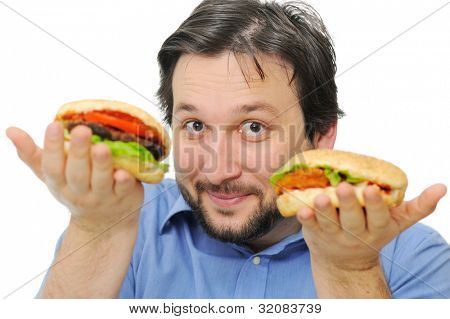Adult man with beard holding two delicous hamburgers