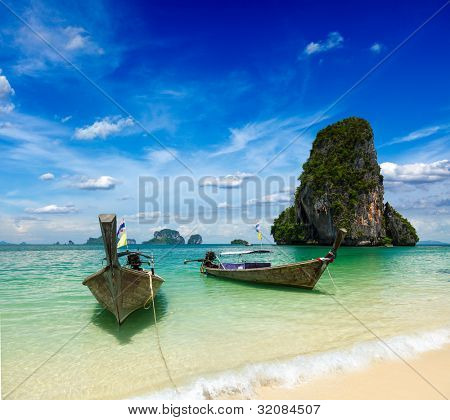 Long tail boats on tropical beach (Pranang beach), Krabi, Thailand