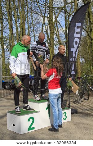 Receiving Flowers On The Podium