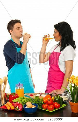 Couple Drinking In Kitchen
