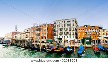 Venezia, Italy - Gondolas on Grand Canal and San Marco bell tower on the left
