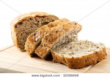 The Cut Bread On A Chopping Board