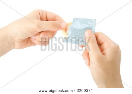 Hands Umwrapping A Condom
