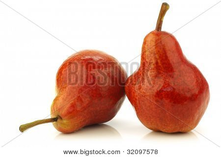 Two fresh Bartlett Pears on a white background