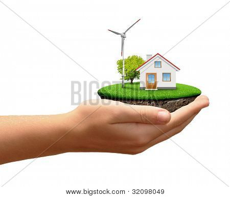 The house with wind turbine in hands isolated on white background