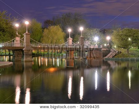 Lagoon Bridge and skyline of Boston, Massachusetts fromthe Boston Public Gardens.