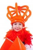 image of blown-up  - Girl with big blown up orange crown for Dutch soccer game or Queens day over white background - JPG