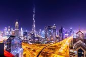 Amazing Skyline Cityscape With Illuminated Skyscrapers. Downtown Of Dubai At Night, United Arab Emir poster