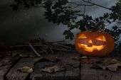 Halloween Pumpkin Glowing In A Mystic  Forest At Night. Jack O Lantern Horror Background. Halloween  poster