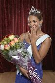 picture of beauty pageant  - Beauty queen holding a bouquet of roses - JPG