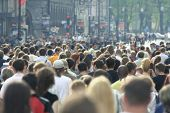 stock photo of crowd  - Lots of people walking on a street - JPG