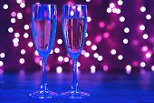 Luxury Party Champagne Glass In Nightclub Neon Lilac, Blue And Purple Lights. Blurry Closeup poster
