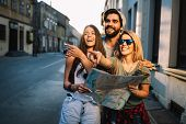 Young Happy Group Of Friends Sightseeing In City poster