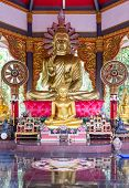 Large Golden Buddha Statue With The Small Buddha Statue Are All Around In The Forest Monastery,north poster