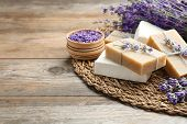 Handmade Soap Bars With Lavender Flowers On Brown Wooden Table. Space For Text poster