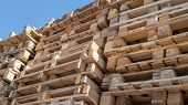 Wooden Euro Pallets For Transfering Goods To Customers. Used Wooden Pallets In Stack In The Warehous poster
