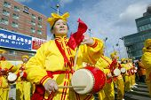 FLUSHING, NY - FEBRUARY 12: Falun Gong members beat drums as they participate in Chinese New Year ce