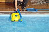 Pool Cleaner During His Work. Cleaning Robot For Cleaning The Botton Of Swimming Pools.  Automatic P poster