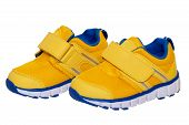 Child Shoe Fashion. Close-up Of A Pair Of Yellow Blue Child Sneaker Or Sport Shoes Isolated On A Whi poster