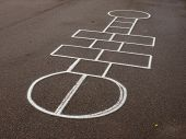 picture of hopscotch  - White hopscotch outdoors on asphalt schoolyard - JPG