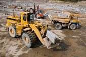 picture of oversize load  - Excavation and dump vehicle in a granite quarry - JPG